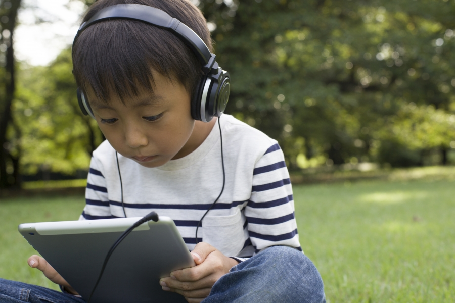 Image result for reading with earphones
